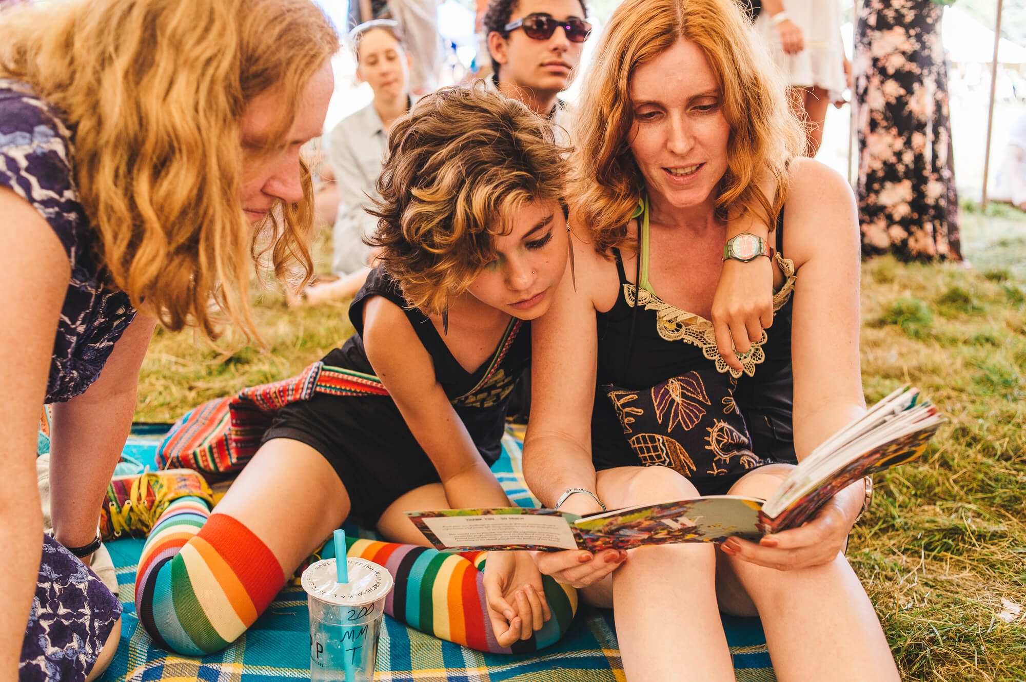 Families reading the programme Wilderness Festival